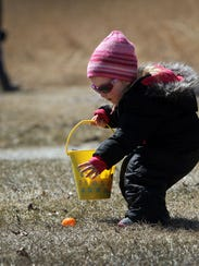 Sarah Bender finds an egg for her Easter bucket at the 2015 town of Lisbon Easter egg hunt. This year's event runs from 12:30 to 2 p.m. Saturday, March 24.
