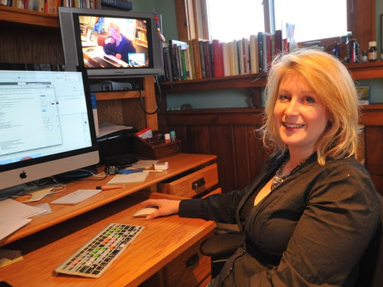 Psychiatrist Jenna Saul uses a webcam to talk with