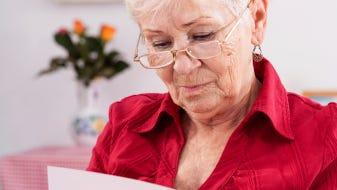 Grandma looking at a greeting card