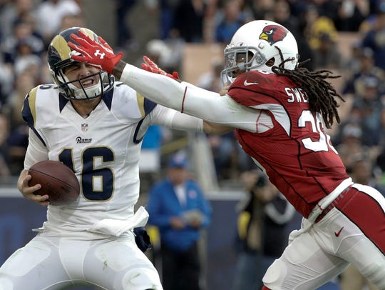D.J. Swearinger sacks Rams quarterback Jared Goff during a game last season at the Los Angeles Memorial Coliseum.