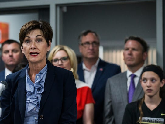 Iowa Governor Kim Reynolds gives a speech before signing