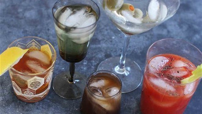 Mixed cocktails, from left, an old fashioned, a vodka gimlet, a Bull Shot, a dry martini and a bloody mary. Now, Massachusetts residents can get them to-go from restaurants.