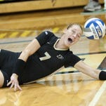 Purdue libero Amanda Neill pops up a pancake dig during the victory over Austin Peay.