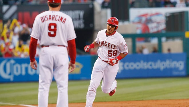 Carlos Perez #58 of the Los Angeles Angels rounds third base after hitting a home run to center field in the second ininng against the Detroit Tigers at Angel Stadium of Anaheim on May 30, 2015 in Anaheim, California.