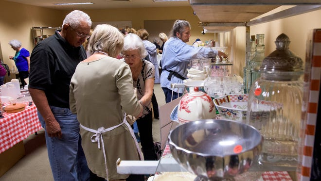 Patrons browse at the bazaar at St. John's Episcopal Church in Montgomery, Ala. on Wednesday November 18, 2015.