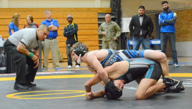 Carlsbad's Cody Wood grabs hold of Oñate's Isaac Rodriguez on Saturday, Jan. 28. Wood, who was fourth overall in the 120-pound division at state, will return for his senior season.