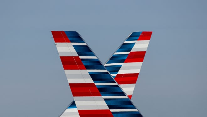 Dueling American Airlines tails cross paths at Chicago O'Hare International Airport in June 2015.