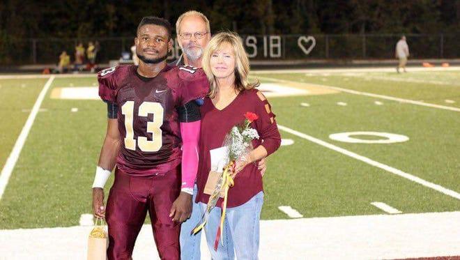 Senior night at Lutheran. Mark Reed and wife, Debbie, with Immanuel.
