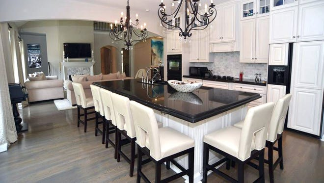 The kitchen at 1983 Eagle Trace Drive features a large island with seating for nine.