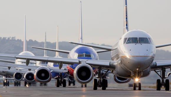 Jets line up for departure during at San Francisco