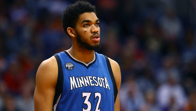 Minnesota Timberwolves center Karl-Anthony Towns  leads the early Rookie of the Year poll.