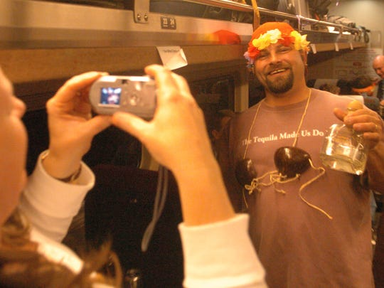 Holly Kellison takes a picture of Scott Rodarte, both of Placerville aboard the Fun Train in 2006, bound for Reno.