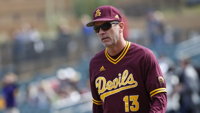 Arizona State coach Tracy Smith brings out the lineup before an exhibition game against the Arizona Diamondbacks at Salt River Fields February 21, 2018.