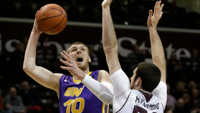 Northern Iowa forward Seth Tuttle (10) shoots over Missouri State center Tyler McCullough (50) during the first half of the Panthers' 68-57 win over Missouri State. Tuttle had a game-high 22 points.