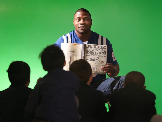 Indianapolis Colts tight end Dwayne Allen reads to students from St. Richards Thursday morning at the Central Library. Part of a Black History Month campaign  in an effort to encourage children to read more.