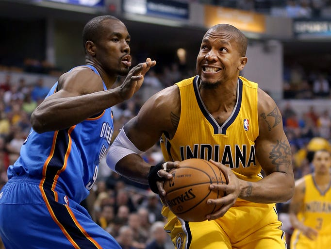 Pacers David West drives on the ThunderÕs Serge Ibaka in the first half of their game Sunday, April 13, 2014, afternoon at Bankers Life Fieldhouse.
