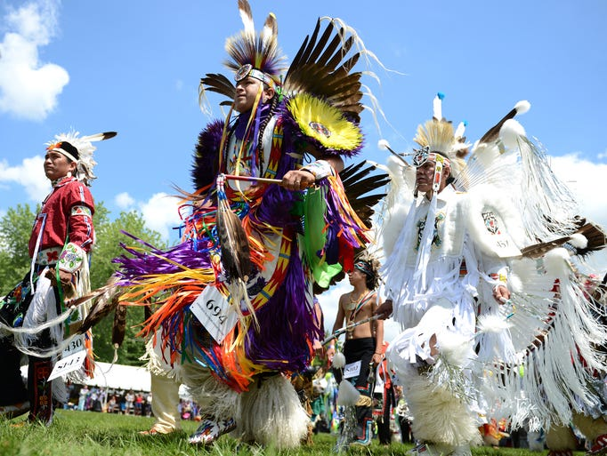 The grand entry for the 42nd Annual Oneida Pow Wow is held at Norbert Hill Center in Oneida, Saturday, July 5, 2014.