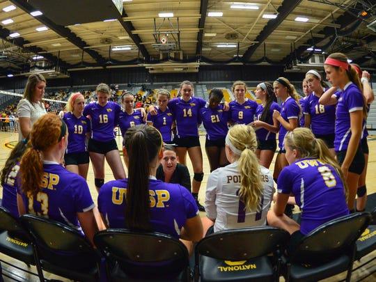 UWSP volleyball coach Abbey Sutherland instructs her