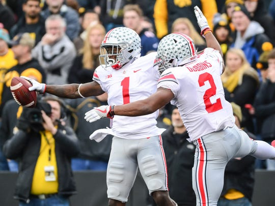 This celebration after OSU's Johnnie Dixon caught a 44-yard touchdown pass would be short-lived. Iowa would respond with 31 unanswered points en route to a 55-24 victory.