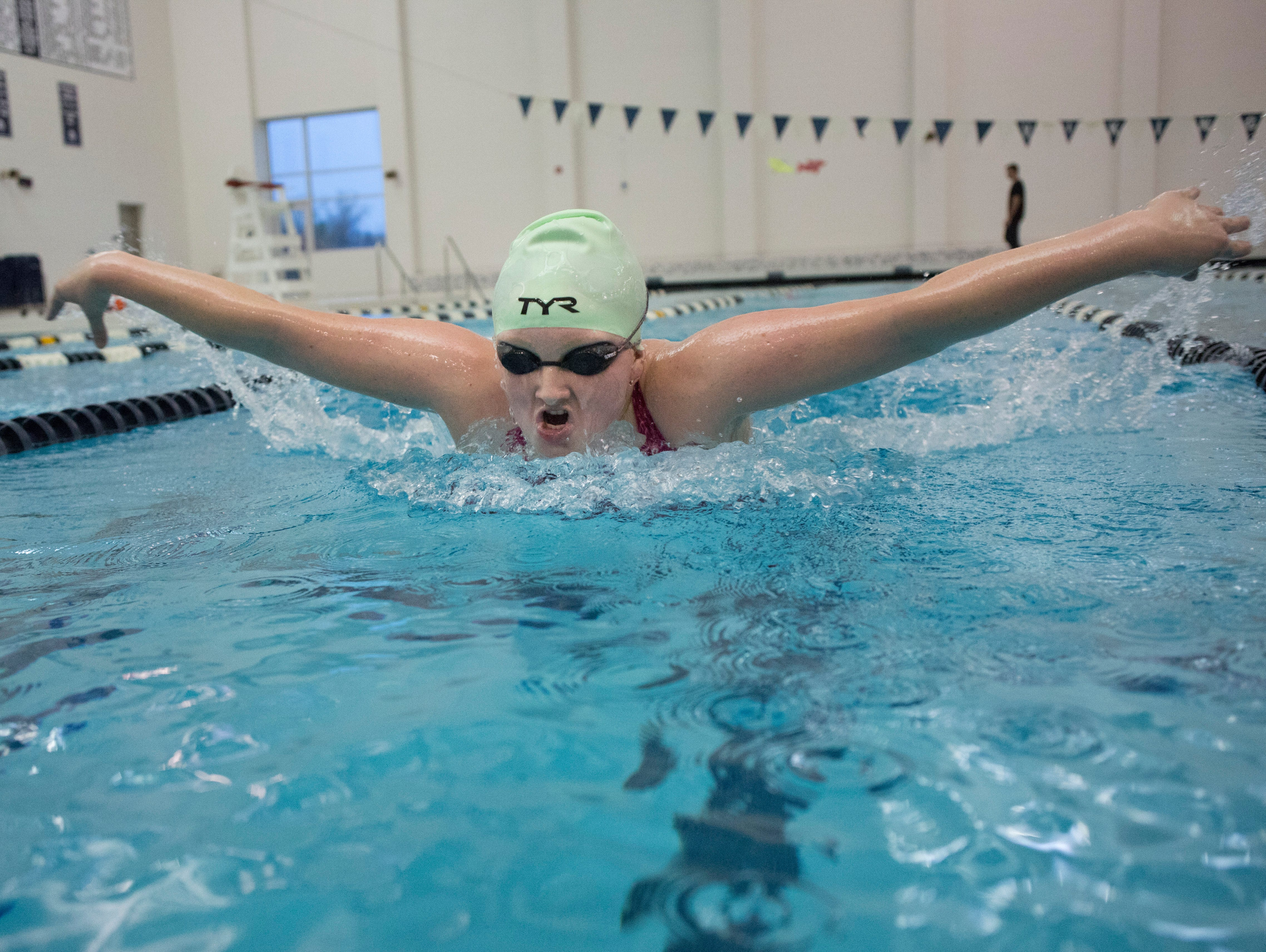 St. Clair freshman Maddie Leaver does the butterfly stroke during practice Wednesday, November 18, 2015 in Marysville.