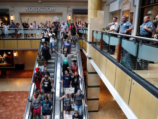 Protesters march through West County Mall in response