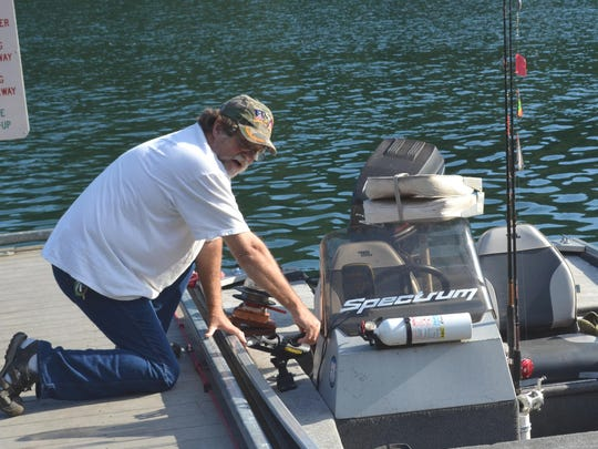 "Ron Scheller gets set to launch his boat at Calkins Boar Ramp, a ritual he does about twice a week. Scheller has trout fishing dialed-in. ""You know, I can catch my limit in about a half-hour just trolling."""
