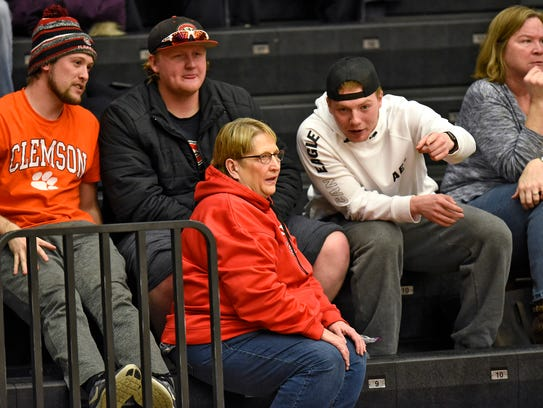 Dawn Schenk  talks with fellow fans during a St. Cloud