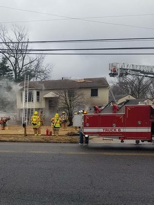 Two Gloucester County EMTs saved a couple from a garage fire on Hessian Avenue on Jan. 24.