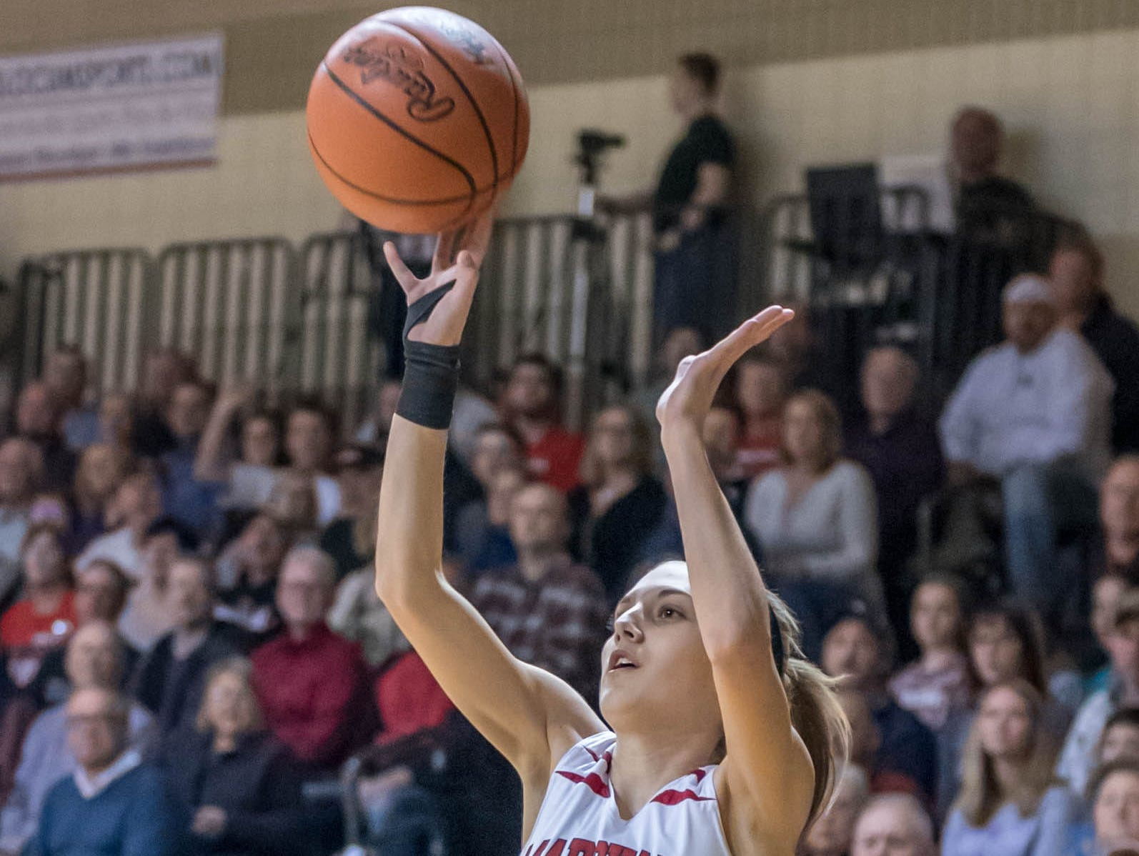 Marshall's Taryn Long (11) takes a jump shot during first half action against Grand Rapids Catholic Central during Class B quarterfinal Tuesday evening.