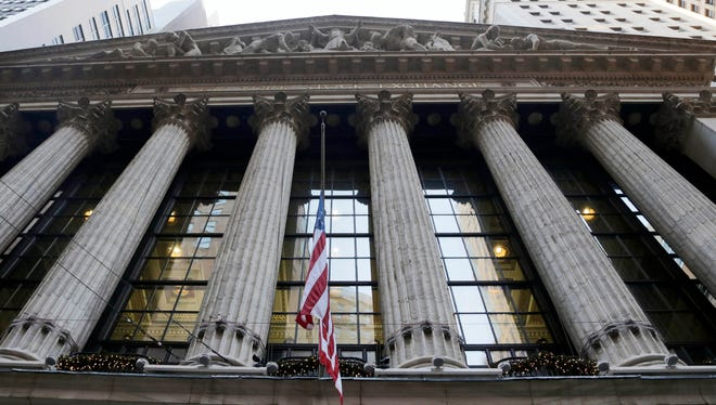 A flag flies on the facade of the New York Stock Exchange.