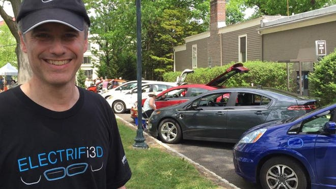 Chris Neff, of Mendham and treasurer of the New Jersey chapter of the national Electric Auto Association, discusses the benefits of owning an electric vehicle at a recent Festival Earth event in Morristown on May 17.