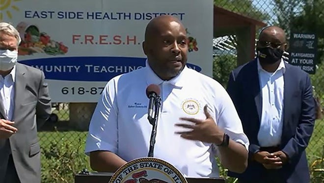 """East St. Louis Mayor Robert Eastern III talks during a news conference Monday in his city about his recovery from COVID-19 this spring. """"I never felt that bad in my life,"""" he said. """"I was scared not knowing what the outcome may be."""""""