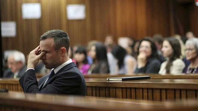 Oscar Pistorius rubs his eye in court in Pretoria, South Africa, earlier this year.