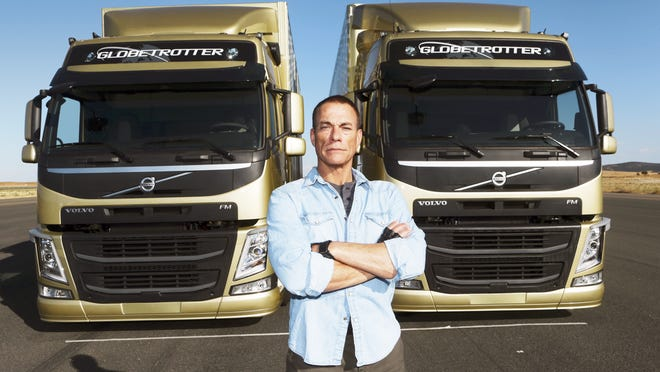 "Jean-Claude Van Damme near the trucks where he performed an ""epic split."""