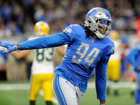 Lions defensive end Ziggy Ansah reacts after a sack during the first half against the Packers, Sunday, Dec. 31, 2017 in Detroit.