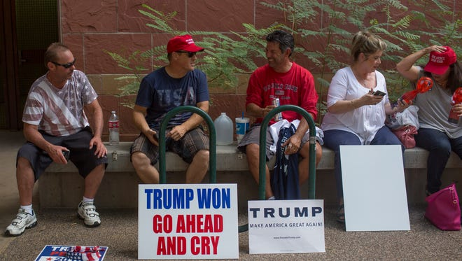 President Trump supporters wait in line for Aug. 22 event.