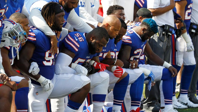 Buffalo Bills players take a knee during the national anthem prior to an NFL football game against the Denver Broncos, Sunday, Sept. 24, 2017, in Orchard Park, N.Y. (AP Photo/Jeffrey T. Barnes)