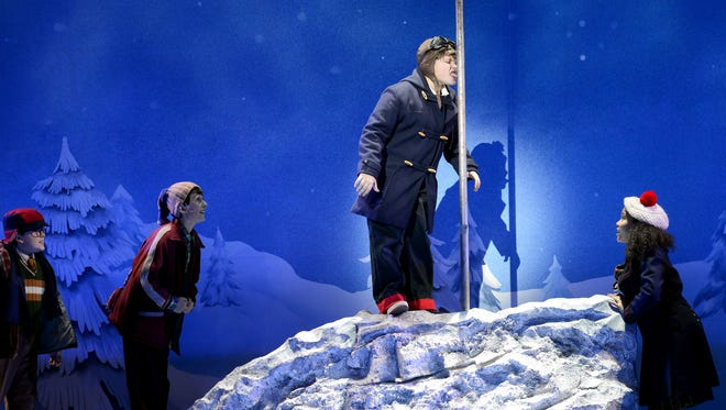 """One of the many iconic scenes from the 1983 movie """"A Christmas Story"""" that is recreated in the touring musical """"A Christmas Story, The Musical,"""" now at the Aronoff Center through Dec. 10."""