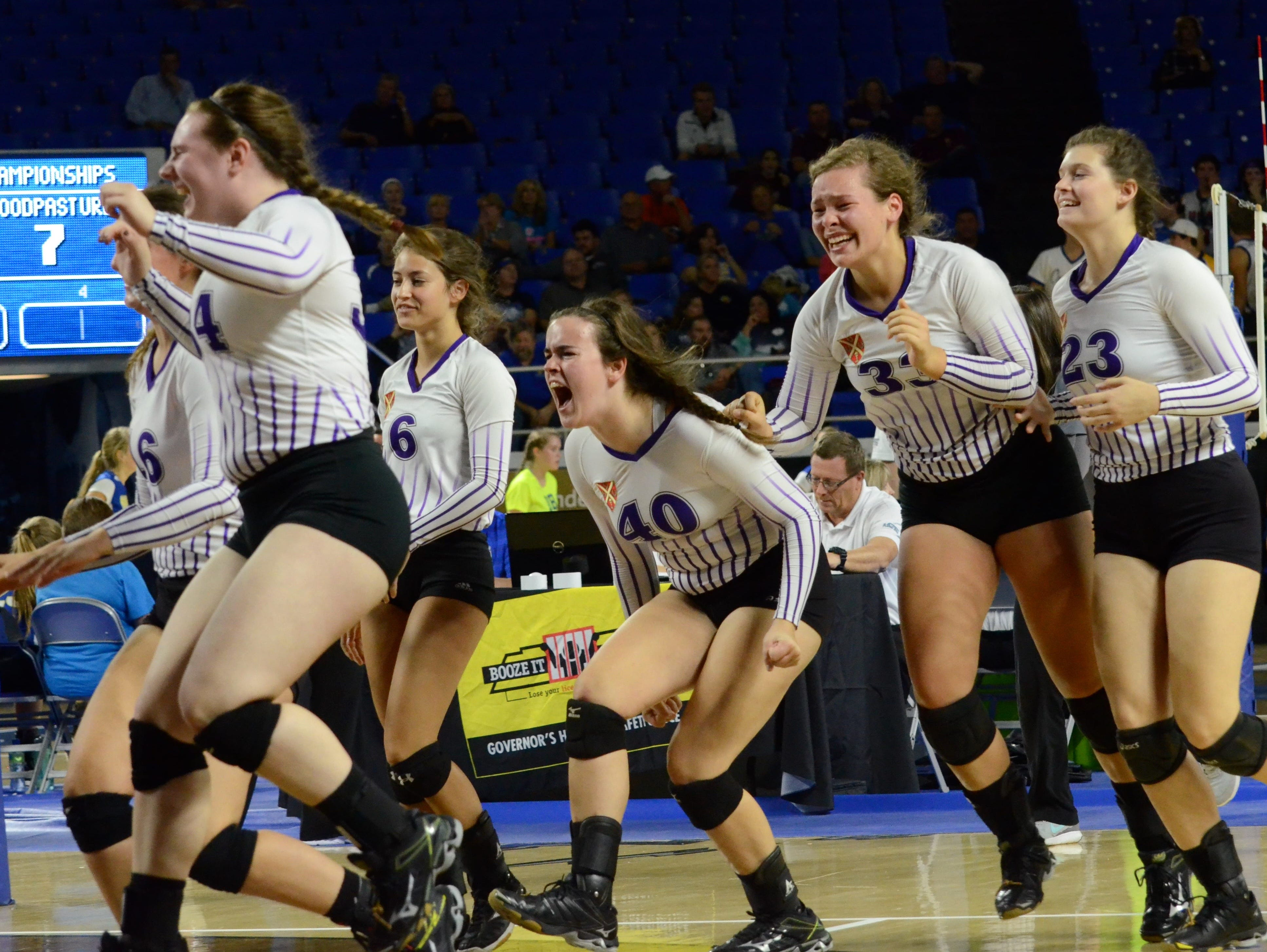 Father Ryan players celebrate advancing to the Division II-AA state volleyball tournament title game Thursday.
