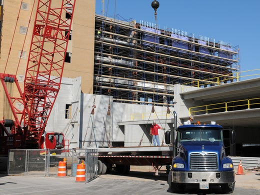 Workers unload concrete panels during renovation of