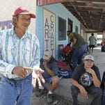 Vernon Move Camp, left, talks Aug. 1, 2013, with Craig Dillon about Pine Ridge Reservation voting to legalize alcohol at East Wind Casino in Martin, S.D.