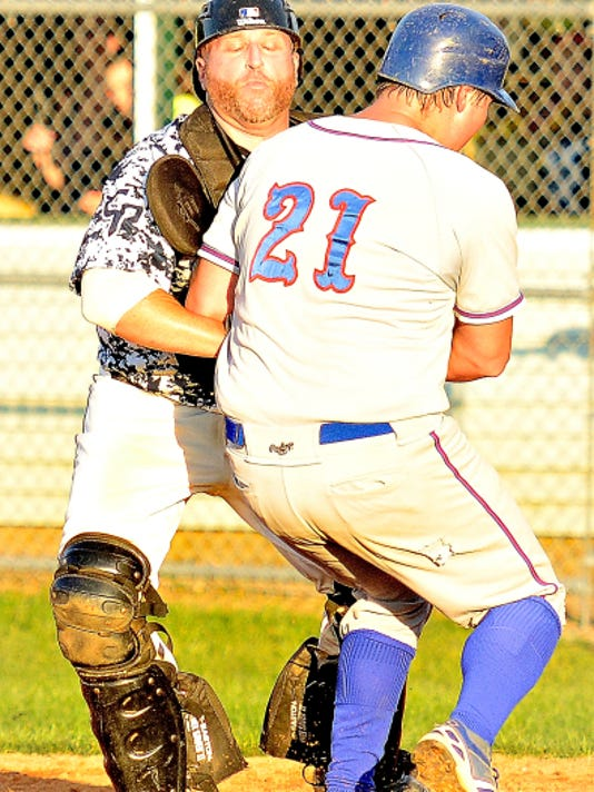 East Prospect's Mark Schauren, back, tags out Conrads' Andrew Gideon during Tuesday's Game 1 in the best-of-5 Susquehanna League Championship Series. East Prospect earned a 6-4 victory.