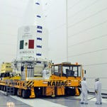 Crews prepare Mexico's Morelos 3 satellite for its Friday, Oct. 2, 2015 launch from Cape Canaveral.