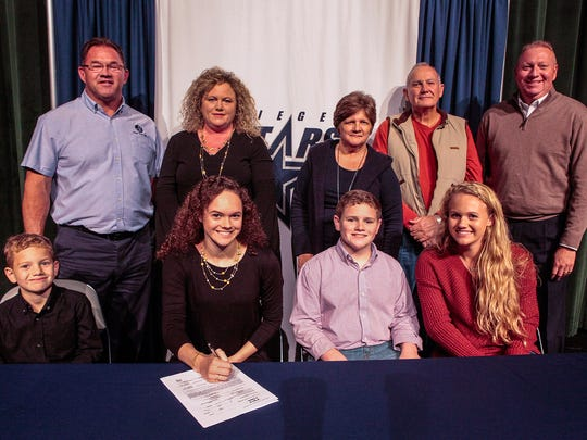 Seigel senior Hannah McCrary signed a gymnastics scholarship to Missouri Wednesday. Pictured in the front row (l-r) are Christian McCrary, Hannah McCrary, Dawson McCrary and Caitlyn McCrary. In the back row (l-r) are Johnny McCrary (father), Holly McCrary (mother), Millie and Jimmy Mingle (grandparents) and Siegel principal Larry Creasy.