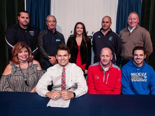 Siegel baseball standout Drew Benefield signed to play at Louisville Wednesday. Pictured in the front row (l-r) are Tracyann Benefield (mother), Drew Benefield, Steve Benefield (father) and Blake Benefield. In the back row (l-r) are Siegel coach Chad Fields, Siegel coach Mike Tobitt, Lexi Hibdon, Siegel coach Craig Reavis and Siegel principal Larry Creasy.