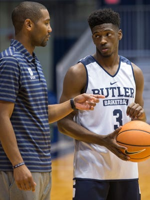 LaVall Jordan (left), head coach, chats with player Kamar Baldwin, sophomore, during practice for the Butler University men's basketball team, Indianapolis, Thursday, October 19, 2017.