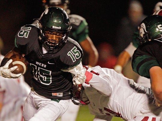 Webb's Elijah Howard (15) runs for yardage as he's hit by Oak Ridge's Kydall Clark during the game on Friday, Oct. 21, 2016.