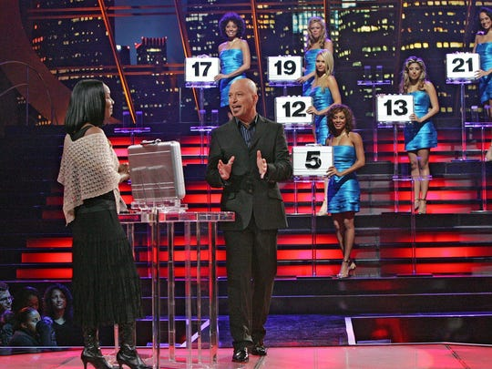 "Host Howie Mandel talks with a contestant on ""Deal"
