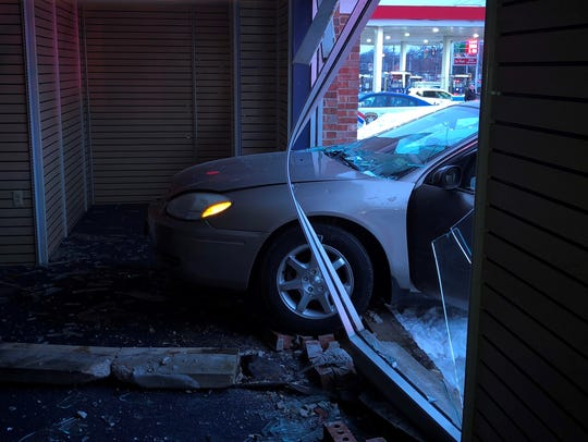 A car jumped a curb and went into a Route 37 office