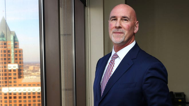 James R. Popp, shown at the 24th floor offices of Milwaukee's Cleary Gull Advisors, an investment unit of Johnson Financial Group, became CEO of Johnson this month.